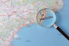 Consultation with magnifying glass map of Barcelona Royalty Free Stock Photography