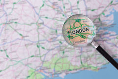 Consultation with magnifying glass map of London Stock Image