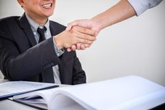 Consultation between a male lawyer and businessman customer, fin. Ancial investment, tax and the company of real estate concept, Handshake after customer service Royalty Free Stock Photo