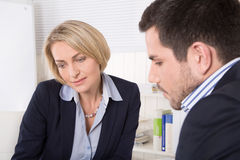 Consultation at office between businesswoman and customer. Stock Images