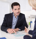 Consultation at office between consultant and customer. Royalty Free Stock Image