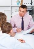Consultation with school headmaster Stock Photography