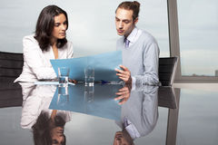 Consultation with tax adviser. Consultation with female financial adviser in a nice office Stock Photo