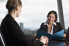 Consultation with tax adviser. Consultation with female financial adviser in a nice office Royalty Free Stock Photos