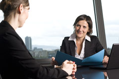 Consultation with tax adviser. Female tax adviser with client in a nice office Stock Photo