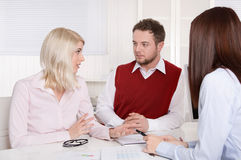 Consultation with young couple at office. Stock Image