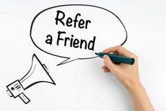 Consulte um amigo Megafone e texto em um fundo branco imagens de stock royalty free