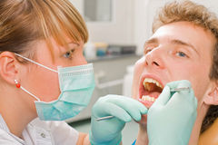 Consulting. Young man at the sweet dentist Royalty Free Stock Images
