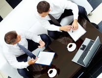 Consulting. Image of two business partners discussing work at meeting Royalty Free Stock Photography