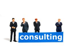 Consulting. Business consulting concept with toy man isolated on white background Royalty Free Stock Photos