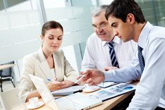 Consulting. A business team of three sitting in office and planning work Stock Photo