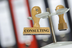 Consulting. Rubber stamp in office marked with consulting Stock Photos