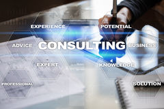 Consulting business concept. Text and icons on virtual screen. Royalty Free Stock Image