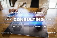 Consulting business concept. Text and icons on virtual screen. Consulting business concept. Text and icons on virtual screen Royalty Free Stock Photo