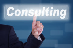Consulting. Businessman pressing a button consulting Royalty Free Stock Images