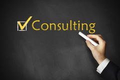 Consulting chalkboard businessman Stock Photography