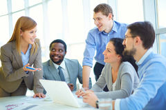 Consulting with co-workers Stock Photography