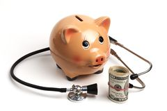 Consulting Dollars Piggy. Cute Piggy Bank With Black Stethoscope and Dollars Roll Banknotes Isolated on White Background stock photography