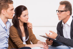Consulting with family psychiatrist. Royalty Free Stock Images