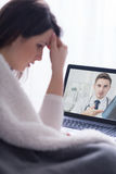 Consulting her physician via webcam Stock Photo