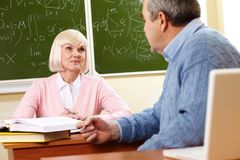 Consulting with teacher Stock Photo