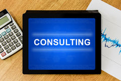 Consulting word on digital tablet Royalty Free Stock Image
