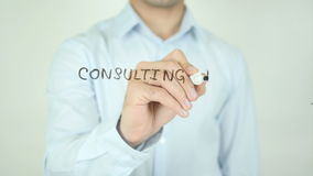 Consulting for Your Business, Writing On Transparent Screen. Man writing stock footage