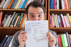 Consumatore colpito da energia e dagli aumenti dell'imposta da pagare fotografia stock libera da diritti