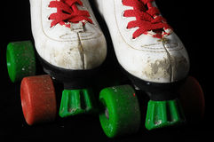 Consumed Roller Skate. Used Vintage Consumed Roller Skate on a Black Background Royalty Free Stock Photography