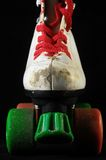 Consumed Roller Skate. Used Vintage Consumed Roller Skate on a Black Background Royalty Free Stock Photos