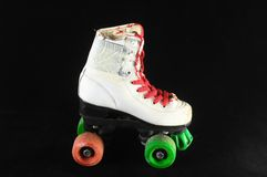 Consumed Roller Skate. Used Vintage Consumed Roller Skate on a Black Background Royalty Free Stock Photo