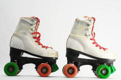 Consumed Roller Skate. Used Vintage Consumed Roller Skate on a White Background Royalty Free Stock Photos