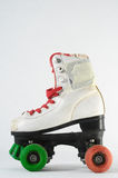 Consumed Roller Skate. Used Vintage Consumed Roller Skate on a White Background Stock Images