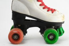 Consumed Roller Skate. Used Vintage Consumed Roller Skate on a White Background Stock Image