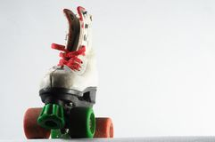 Consumed Roller Skate. Used Vintage Consumed Roller Skate on a White Background Stock Photography