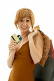 Consumer girl. Pretty girl with credit cards and shopping bags Royalty Free Stock Image
