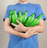 Consumer with a lot of bottles of beer. In their hands Royalty Free Stock Photography