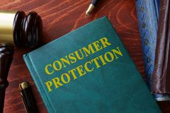 Consumer protection title on a book. royalty free stock image