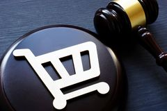 Consumer rights. Shopping cart and gavel. Consumer rights concept. Shopping cart and gavel royalty free stock photos