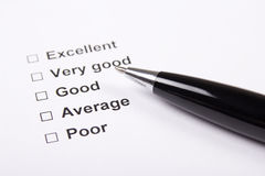 Consumer survey with questionnaire checkbox and pen Stock Photo