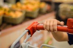 Consumer walking around and wheeling cart at Royalty Free Stock Photo