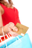 Consumerism. Close-up of woman�s hand holding plastic card and giving it to shop assistant Royalty Free Stock Photo
