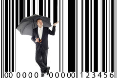 Consumerism. Businessman under one umbrella, in between a large barcode, metaphor boss, manager, consumerism stock images