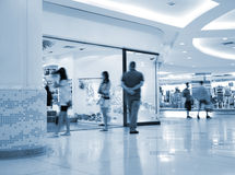 Consumerism. A toned photo of a shopping mall Royalty Free Stock Photo