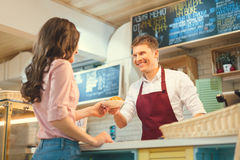 Consumerism. Buying girl in a bakery Stock Photos