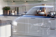 Consumerism. Car reflected in the window of a kitchen supplier Stock Photography