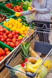 Consumerism concept. Woman doing grocery shopping at supermarket.  Stock Image