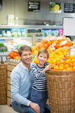 Consumerism. Dad and son in a store Royalty Free Stock Images