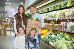 Consumerism. Family with bag in a store Royalty Free Stock Photography