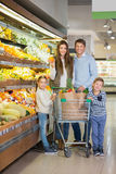 Consumerism. Family with a cart in store Royalty Free Stock Photos
